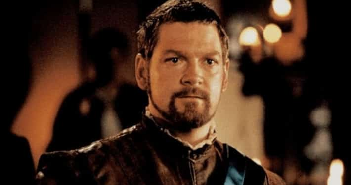 Kenneth Brannagh looking at the camera in brown tunic as Othello